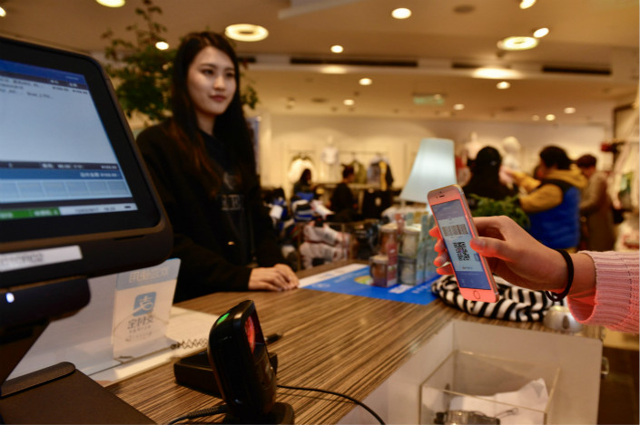 The People's Bank of China has been asked to approve a database that would help internet finance firms and commercial banks better analyze consumers' credit histories before they extend loans. Photo: Visual China
