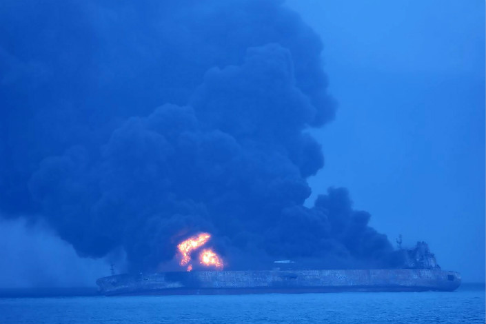 The oil tanker Sanchi burns off the Chinese coast after colliding with a cargo ship on Saturday. Photo: Visual China
