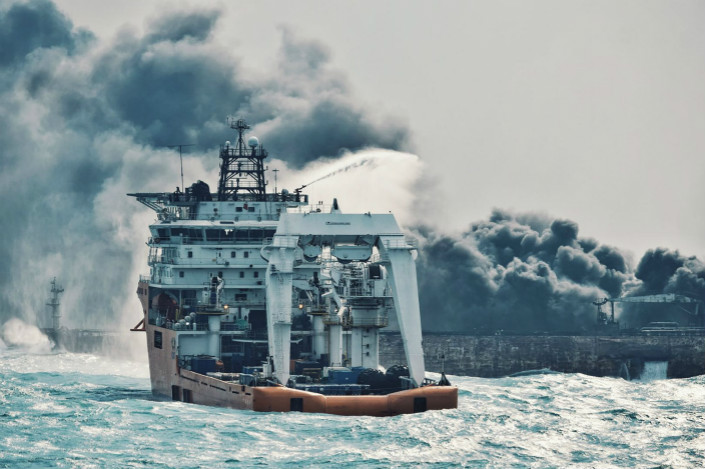 Chinese officials said that the Panamanian-flagged oil tanker Sanchi was already on fire when it collided with the Hong Kong-flagged cargo ship CF Crystal in the East China Sea on Saturday. Above, the Chinese ship Shen Qian Hao (foreground) sprays foam on the Sanchi on Wednesday before the arrival of firefighting crews that night. Photo: Visual China