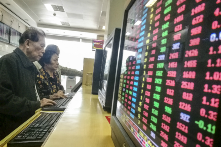 The revised guidelines on pledged-stock borrowing, which will take effect on March 12, stipulate that pledged-stock repurchase contracts cannot be longer than three years. Photo: Visual China