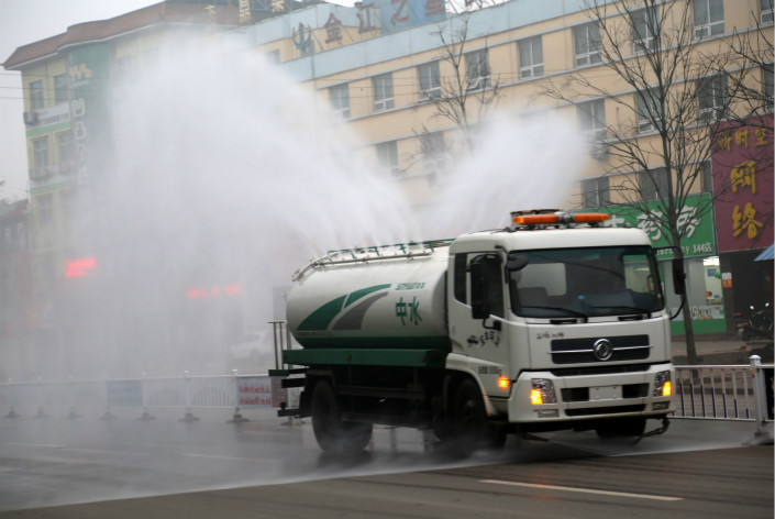 The use of mist cannons such as the one pictured, which blast nebulized liquid to flush out dust, has interfered with air quality monitoring activities, China's environment ministry said. But the authorities didn't offer details of when the incidents occurred and how much they altered data. Photo: Visual China