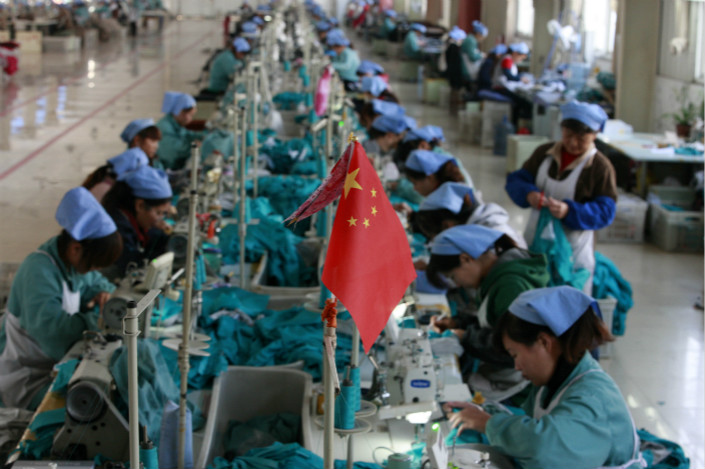 In Huaibei, Anhui province, female workers in a state-owned garment factory process clothing for export to the European Union.  State-owned enterprise revenues rose 14.7% to 50 trillion yuan ($7.7 trillion) in 2017. The companies paid 3.7 trillion yuan in taxes, up 11.5%, according to China Central Television. Photo: IC