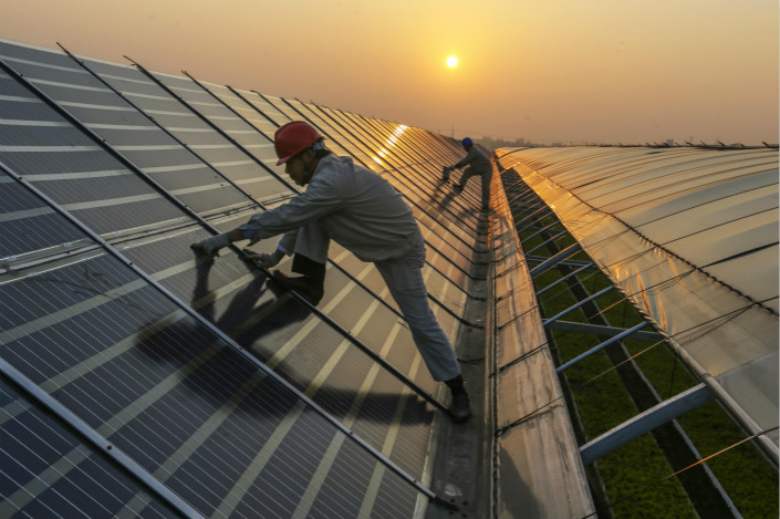 China likely installed more than 50 gigawatts of new solar capacity in 2017, marking an enormous increase over the nearly 35 gigawatts added the previous year. Photo: Visual China