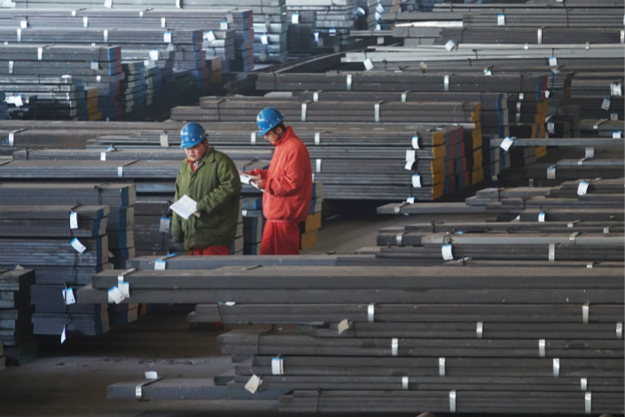 "Workers check steel products at a warehouse on Nov. 27 in Dalian, Liaoning province. In January 2017, central government inspectors found ""data fabrication widely exists in the entire province of Liaoning."" Photo: Visual China"