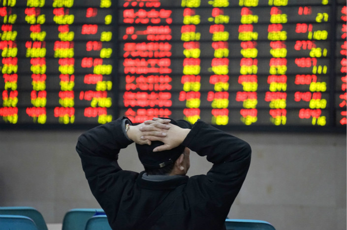 The  China Securities Regulatory Commission has barred the country's brokerages from underwriting privately placed bonds for companies whose key subsidiaries have defaults on their records. Photo: Visual China