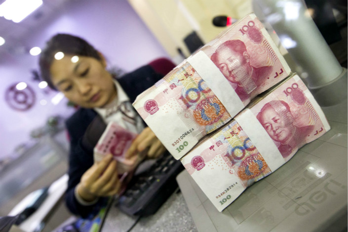 Market insiders told Caixin that tighter rules on the changing of controllers of certain market funds is another move to stop investment in nonstandard assets. Photo: Visual China