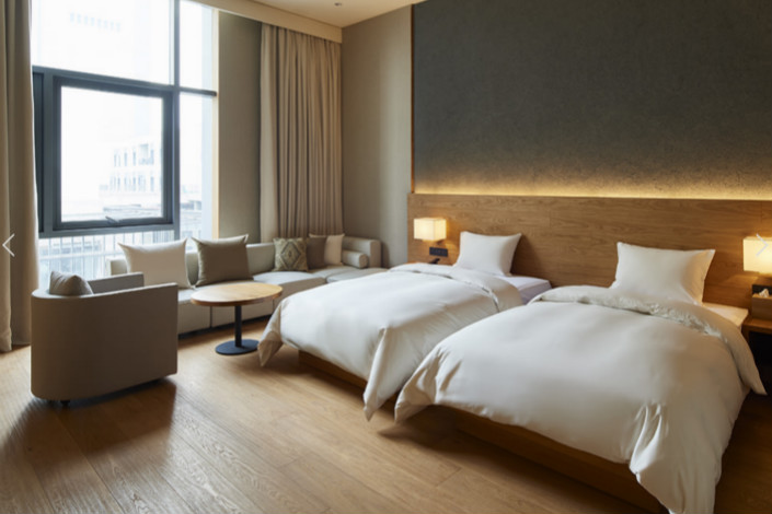 A room at Muji's new Shenzhen hotel is seen. The Japanese housewares retailer's first-ever hotel offers rooms starting at $148 a night. Photo: Muji
