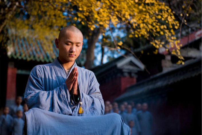 "Buddhist monk sits in meditation at Shaolin Monestary in Henan province. ""Foxi,"" or ""being Buddhist,"" became a viral meme among Chinese millennials since December, who use it to refer to one who refuses to succumb to societal pressures. Photo: Visual China"