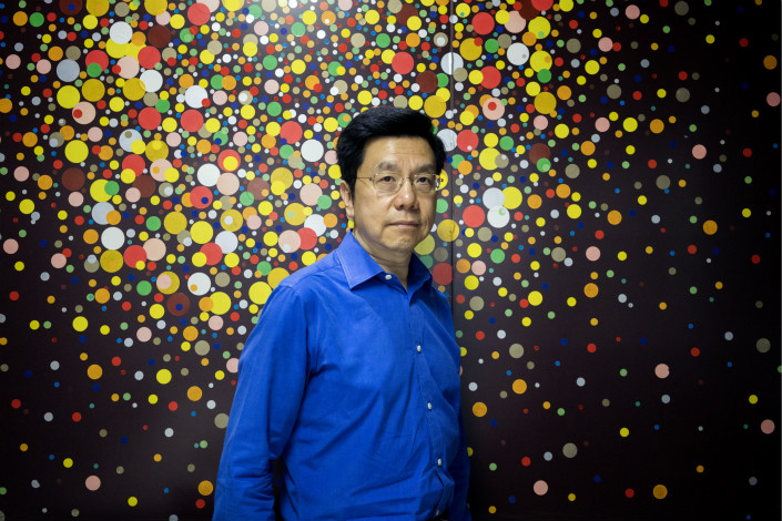 Kai-Fu Lee, founder of Sinovation Ventures, poses for a photograph in Beijing on Aug. 15. Sinovation Ventures' latest endeavor, an in-house artificial intelligence institute, has about 30 full-time employees, which it plans to increase to about 100 within the year. Photo: Visual China