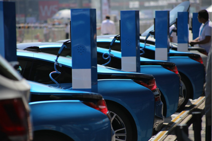 BMW electric cars charge in Shanghai on May 11, 2016.  China's government is beginning to phase out electric-vehicle subsidies this year, will total removal of the program expected by 2020. Photo: IC