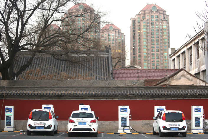 "Shared electric vehicles charge next to a Beijing temple on Jan. 16. ""Nationwide, the average usage rate for electric chargers is 15%,"" said Xu Yanhua, chairman of the Charging Infrastructure Alliance, a government think tank. That would mean a charger was being utilized for only 15% of a given 24-hour period. Photo: Visual China"