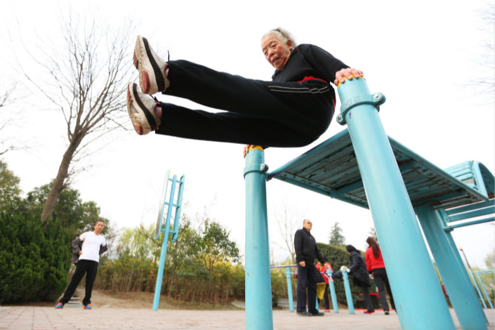 Zhang Huifang, 85, works out at a park in Xi'an in March. A country is considered to have an aged society when the proportion of people over 65 years old reaches 14% of the population. In China, the figure rose to 11.4% in 2017. Photo: Visual China