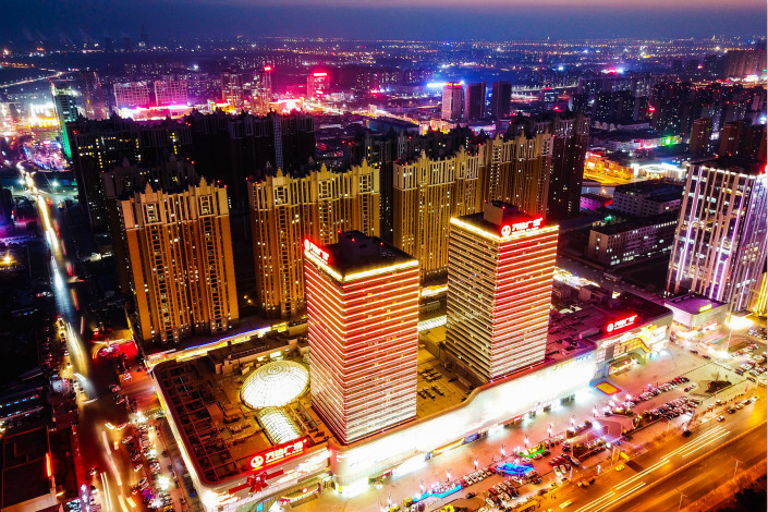 An aerial view of a Wanda Plaza commercial retail space in Dongying, Shandong province. Wanda Chairman Wang Jianlin said the company plans to open two malls and 50 new Wanda Plaza projects in 2018. Last year, Wanda opened 49 new plaza projects. Photo: Visual China