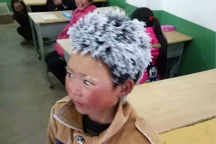 This photo of third-grader Wang Fuman, of Yunnan province, triggered an online discussion earlier this month on the plight of rural students who have to walk great distances in the cold to get to school. Photo: IC