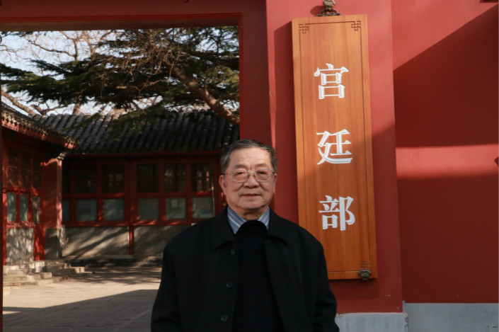 Liang Jinsheng, 70, stands at the entrance to the Palace-Study Department of the Forbidden City, where he has worked for nearly four decades, cataloging the 1.8 million relics in the palace compound. Photo: Wei Xiding/Caixin