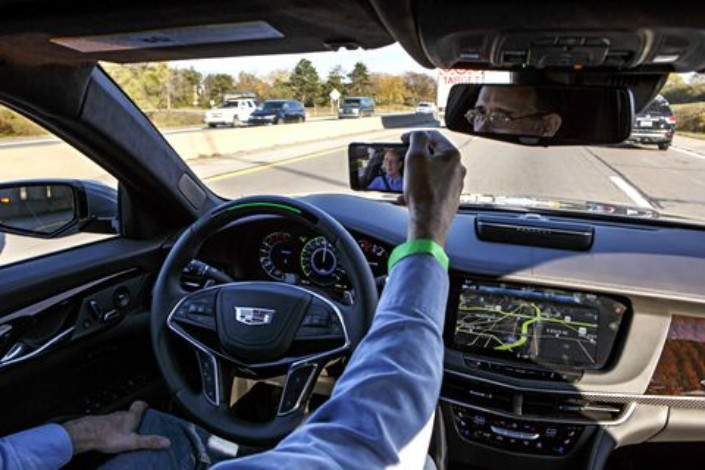 Unlike existing smart-car technologies, Cadillac's Super Cruise doesn't require a driver to keep either hand on the steering wheel, under certain conditions. Photo: IC