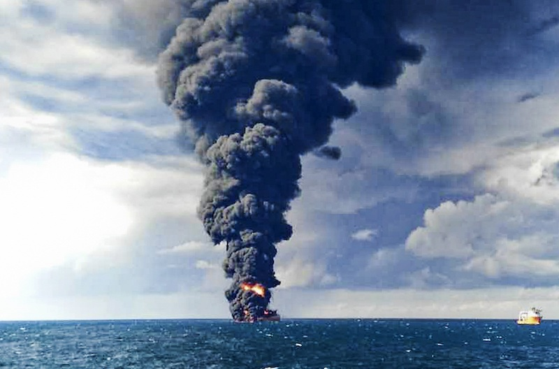 A toxic plume rises above the oil tanker Sanchi, pictured, which collided with a grain ship on Jan. 6 in the East China Sea. Photo: AP