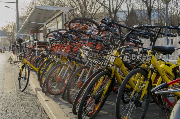 Shared bikes are piled up on a Beijing street on Jan. 16. The Chinese capital currently has 2.2 million shared bikes, down from 2.35 million four months ago, said Zhou Zhengyu, director of the Beijing Municipal Commission of Transportation. Photo: VCG