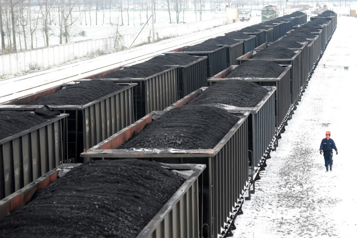 A freight train loaded with coal in East China's Anhui province. China's four largest state-owed power companies argue that rising transportation fees, combined with weak supply, pose serious challenges to their business prospects. Photo: VCG