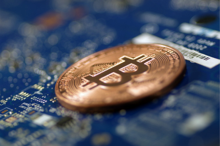 The acquisition of BTCC by a Hong Kong-based blockchain investment fund comes amid signs that China's regulators are determined to stamp out cryptocurrency trading. Photo: VCG
