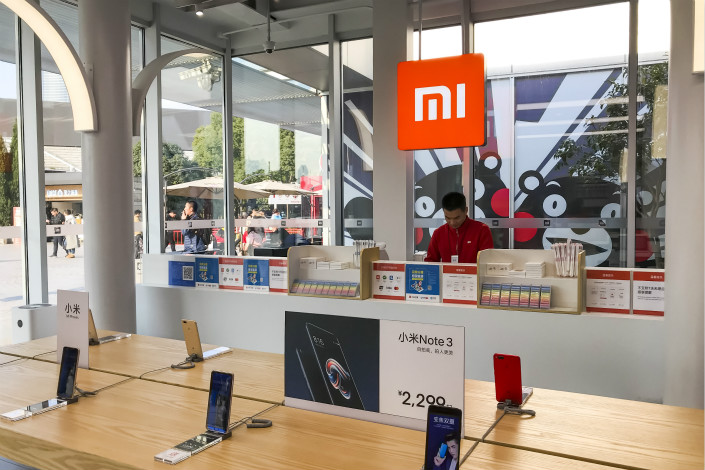 Xiaomi Inc. products are displayed at the Oriental Pearl Radio & TV Tower in Shanghai on Dec. 21. Xiaomi sold 31 million smartphones in the final three months of 2017, up 83% from a year earlier and giving it 7.5% of the global market. Photo: VCG