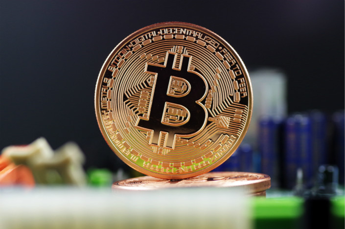Regulators will block access to cryptocurrency trading websites that operate domestically, according to Financial News, a newspaper run by the People's Bank of China. Photo: VCG
