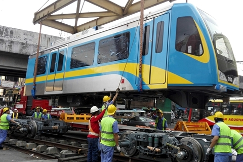 CRRC Dalian built 40 trains for the metro system of the Philippine capital city of Manila. Above: workers assemble a train delivered by CRRC Dalian in Manila. Photo: Visual China