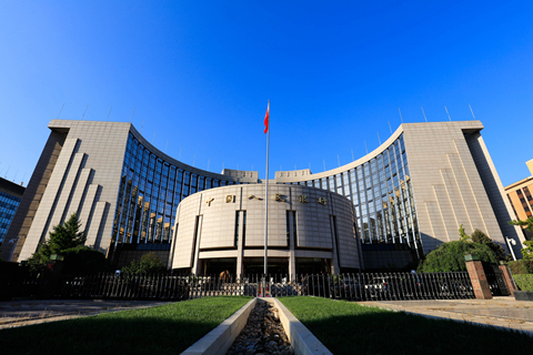 A view of the People's Bank of China headquarters in Beijing. The draft rules released on Nov. 17, which may soon come into force, aim to set industry-wide requirements for leverage ratios, risk reserve funds and investment restrictions, in an effort to get banks' off-balance sheet assets back under a regulatory framework. Photo: VCG