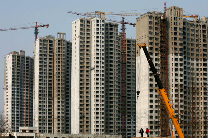 Workers build residential blocks in Changzhou, Jiangsu province on Jan. 29. Of the 600,000 migrants to first- or second-tier surveyed by property group Anjuke, just 25% said they hoped to stay and buy a place in their adopted city, largely on the prospects of career development. Photo: VCG