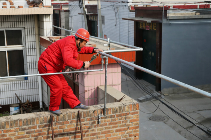 Workers in rural Renqiu, Hebei province, install natural gas pipelines in November 2016. The Environmental Protection Ministry has promised that sufficient natural gas will be available to help millions of North China homes make the switch from coal or electricity. Photo: VCG
