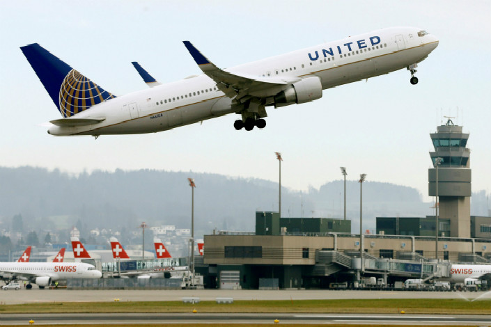 A United Airlines Boeing 767-322ER jetliner takes off from Zurich Airport on Jan. 9. United Airlines said it is pulling back from second-tier Chinese cities for the moment, following the recent cancellation of flights from the U.S. to Hangzhou and Xi'an. Photo: VCG