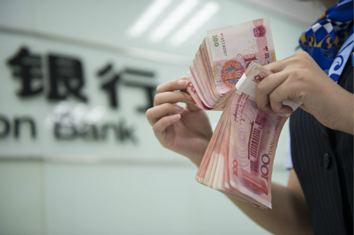 As China's economic structure continues to optimize, slower money-supply growth can still support a rapidly growing economy, the People's Bank of China report said. Photo: IC