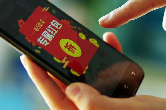 Tencent gave out 1.79 billion red envelops worth a total of 200 million yuan to 221 million users through its QQ messaging platform during the Lunar New Year, the Internet giant said on Monday. Photo: VCG