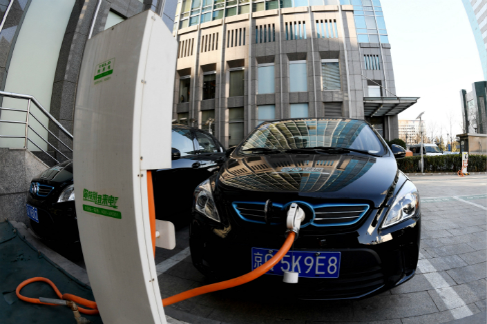 A new-energy vehicle gets recharged at a Qingdao TGOOD Electric Co. Ltd. charging station in Beijing on Jan. 12. A joint venture between a TGOOD-owned company and a Didi Chuxing subsidiary will focus on tailoring the TGOOD-controlled charging technology and network for car-hailing drivers. Photo: VCG