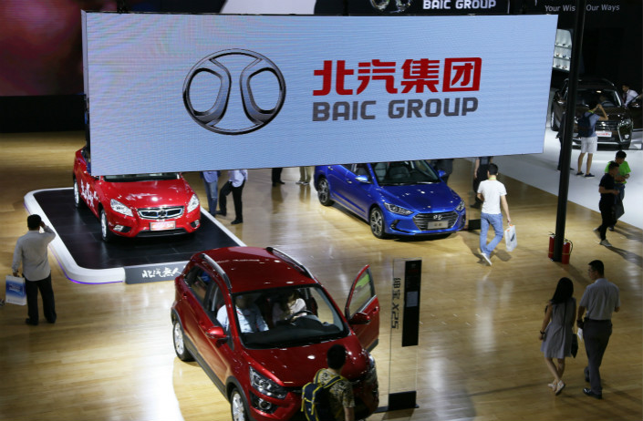 BAIC Motor Corp. displays its automobile models at the Beijing Science and Technology Industry Expo in May 2016. A new factory that BAIC and Daimler AG will build in China will manufacture luxury Mercedes-Benz cars, including new-energy vehicles. Photo: VCG
