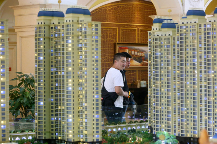 A real estate office in Huaian, Jiangsu province, is seen on Sept. 17. In 21 surveyed Chinese cities, the average number of property sales in February plunged 38.2% from January. Photo: VCG