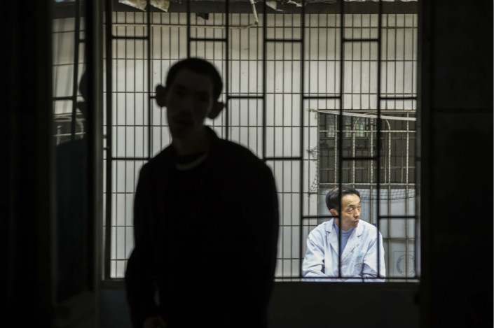 A patient and a staff member in a Guangzhou mental hospital. Under the new guidelines, prosecutors at all levels are obliged to conduct in-depth interviews with suspects who were detained in mental health wards before they were charged. Photo: VCG