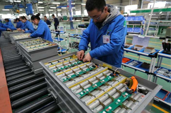 "A new-energy car battery pack is assembled at the the OptimumNano Energy Co. Ltd. plant in Shiyan, Hubei province, in March 2017. New guidelines to take effect in August say new-energy car producers and their sales units must set up ""recycling service networks,"" where spent batteries will either be repaired for reuse or properly disposed of. Photo: VCG"