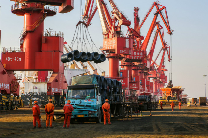 Steel is loaded onto a truck in a port in Lianyungang, Jiangsu province, in March 2017. The China Nonferrous Metals Industry Association said new U.S. tariffs on steel and aluminum will undermine the international trade order, leading to retaliation by its trading partners, including China. Photo: VCG