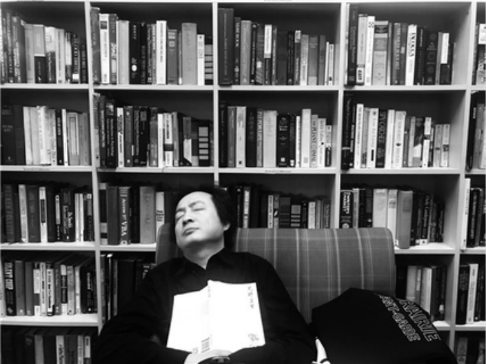 "Ai Guozhu, more popularly known by his pen name, A Yi, dozes off at a Beijing bookstore. A Yi describes himself as ""a cruel writer"" who wants to explore how ""merciless"" humans can be. Photo: Yilin Press"