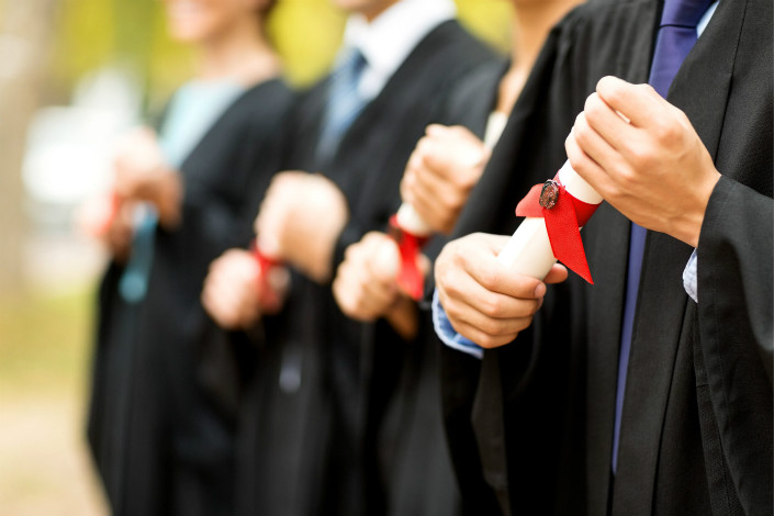 The surge in the number of postgraduates has been driven in part by a change in statistical methodology, but an analyst told Caixin that the tough graduate job market and how college funding is allocated has also played a role. Photo: VCG