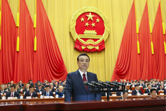 Premier Li Keqiang delivered a report on the government's work as the first session of the 13th National People's Congress kicked off Monday morning. Li said the gross domestic product growth target of about 6.5% will ensure that China meets its social development objectives. Photo: China News Service