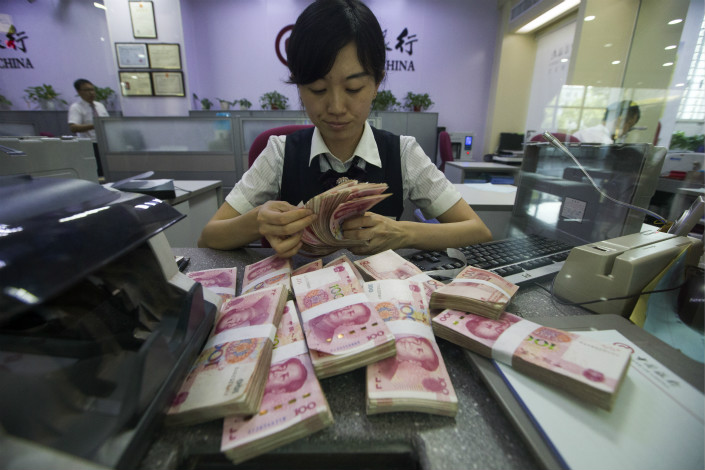 Banks that fulfill certain conditions will be able to reduce their loan-loss provisions to as low as 120% of their bad loans, the China Banking Regulatory Commission said. Photo: VCG