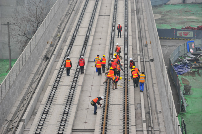 Construction takes place on the Chengdu-Pujiang section of the Sichuan-Tibet Railway in Chengdu, Sichuan province, on Jan. 30.  China Railway Corp. General Manager Lu Dongfu said reduced spending on rail development doesn't mean the government is reducing its support for the industry, as some have said. Photo: VCG