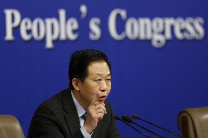 Finance Minister Xiao Jie talks to reporters during a news conference on the sidelines of the National People's Congress at the media center in Beijing on Wednesday. Xiao said China will continue expanding government spending to facilitate economic reforms and social welfare programs. Photo: IC