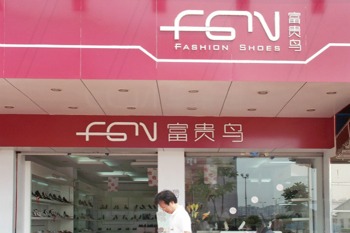 A Fuguiniao shoe store is seen in Shantou, Guangdong province. By the close of trading on Tuesday, the price of the company's bond, 14 Fuguiniao, had plummeted 91.8% to 8.56 yuan ($1.35), a fraction of its par value of 100 yuan. Photo: VCG