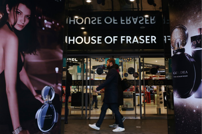 A shopper passes the entrance to a House of Fraser department store in London on Dec. 21. Photo: VCG