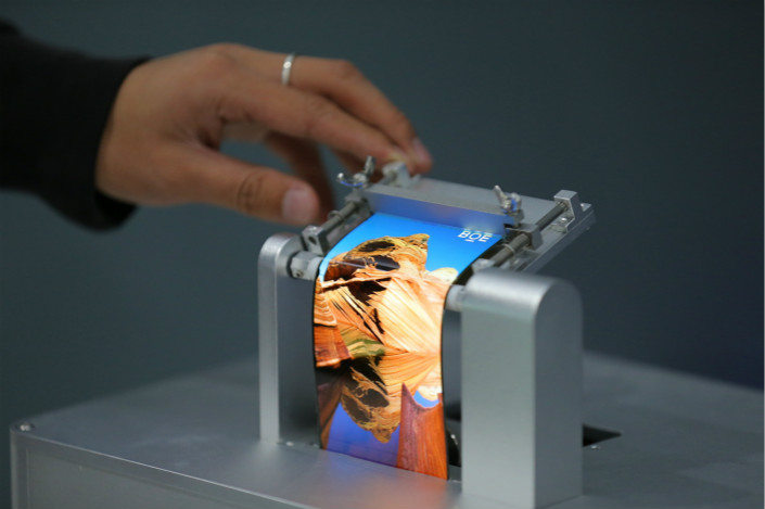 BOE Technology Group Co. Ltd. displays one of its flexible screens on Oct. 13. Photo: VCG