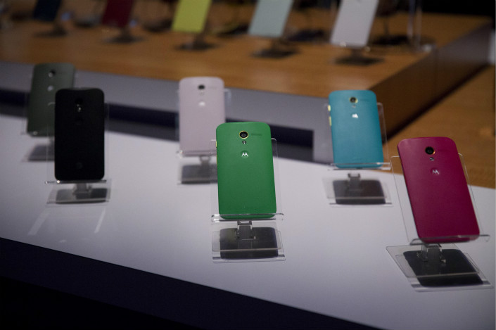 Motorola Mobility Moto X phones are displayed during a launch event in New York in 2013.  Photo: VCG