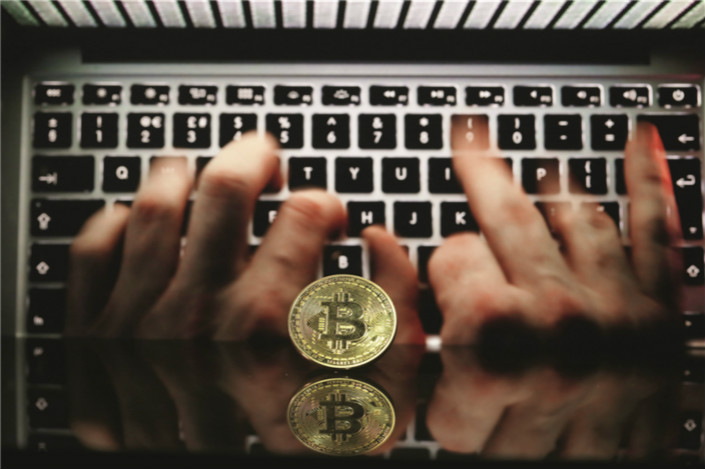 Despite sweeping bans on cryptocurrency fundraising and trading that began last year, Chinese investors have continued to find ways to buy into the volatile and lucrative digital tokens. Photo: VCG